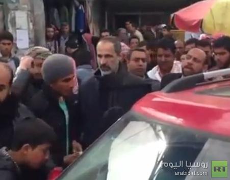 معاذ الخطيب يتجول شمال سورية