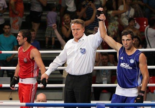 الملاكم الروسي بوتايف يبلغ ربع نهائي يونيفرسياد قازان 2013