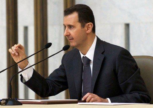 الأسد يؤكد التزامه بخطة تدمير السلاح الكيميائي وينفي استخدامه في الغوطة الشرقية