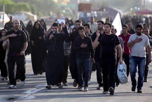 مقتل 21 شخصا وجرح العشرات بانفجارات استهدفت زوارا شيعة في بغداد