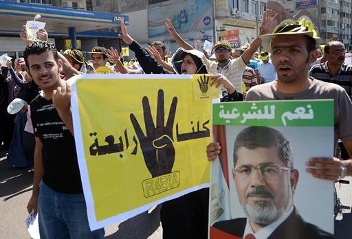 نشوب اشتباكات أثناء مسيرات نظمها أنصار مرسي في أنحاء مصر
