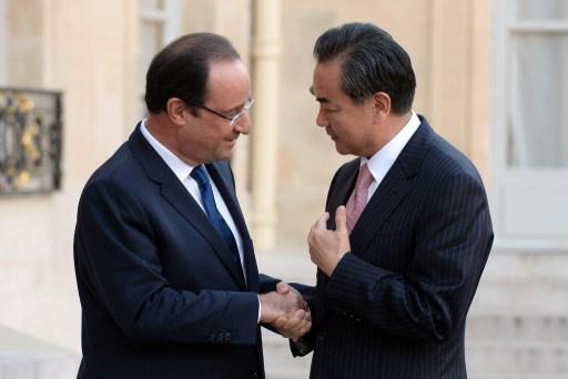 هولاند يبحث مع وزير خارجية الصين قضايا كوريا الشمالية وإيران والأزمة السورية