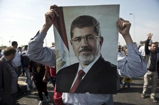 تأجيل محاكمة مرسي لجلسة 8 يناير 2014 ونقله إلى سجن برج العرب في الإسكندرية
