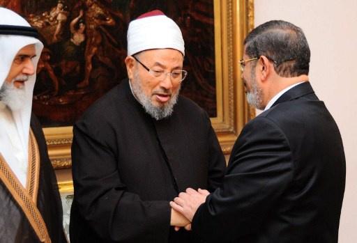"""إحالة مرسي والقرضاوي وعناصر """"حماس"""""""
