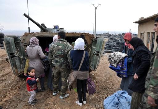 إجلاء الآلاف من سكان عدرا بريف دمشق الى أماكن آمنة