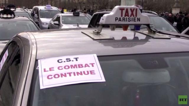 بالفيديو: فرنسا: 55 ألف سائق سيارة أجرة يحتجون على مزاحمة السيارات السياحية للقمة عيشهم