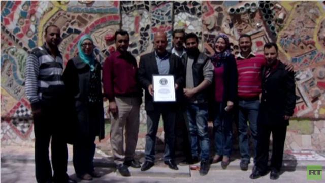 أكبر لوحة جدارية مصنوعة من النفايات في دمشق تدخل موسوعة غينيس (فيديو)