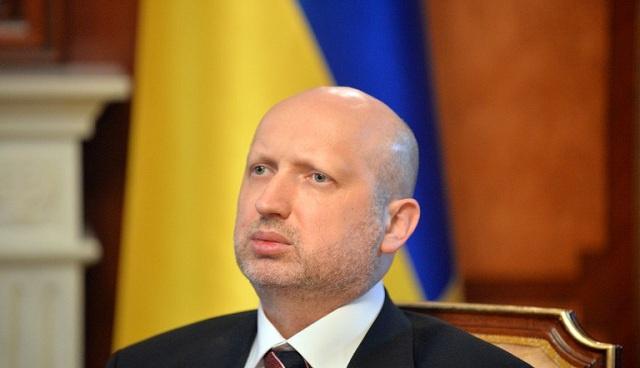 تورتشينوف يتعهد بعدم استخدام القوة ضد المسالمين بشرق أوكرانيا وبإجراء استفتاء حول نظام الحكم