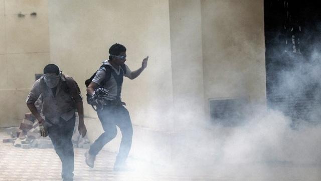 مقتل طالب في اشتباكات بجامعة القاهرة بين طلاب الإخوان و قوات الأمن