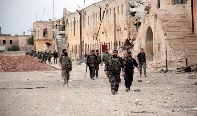 الجيش السوري يستعيد السيطرة على مدرسة حطين بحمص وسقوط قذائف هاون قرب البرلمان بدمشق