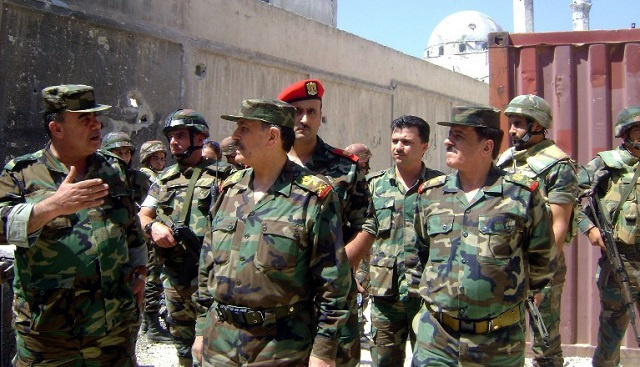 شروط الاتفاق حول انسحاب مسلحي المعارضة السورية من وسط حمص