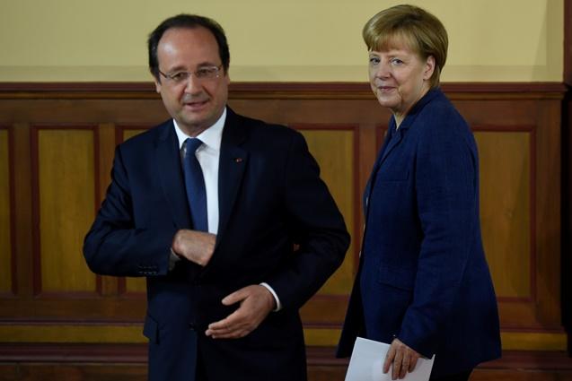 هولاند وميركل: يتعين على كييف الامتناع عن العمليات الهجومية قبل انتخابات الرئاسة
