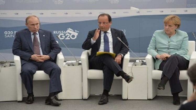 بوتين يشدد في حديث مع هولاند وميركل على ضرورة بدء الحوار لحل الأزمة الأوكرانية