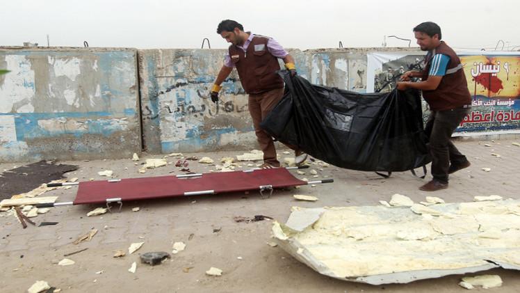 عشرات القتلى في هجوم على موكب للشرطة العراقية جنوبي بغداد