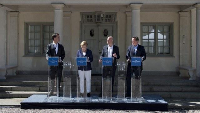 ميركل تؤيد ترشيح جان كلود يونكر لرئاسة المفوضية الأوروبية