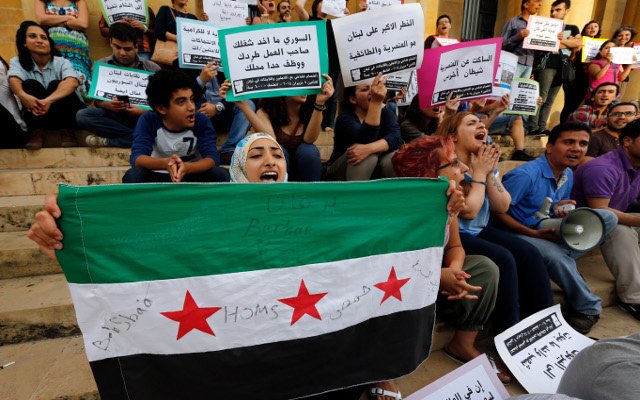 السجن 5 سنوات لـ13 سوريا تظاهروا ضد بشار الأسد في القاهرة