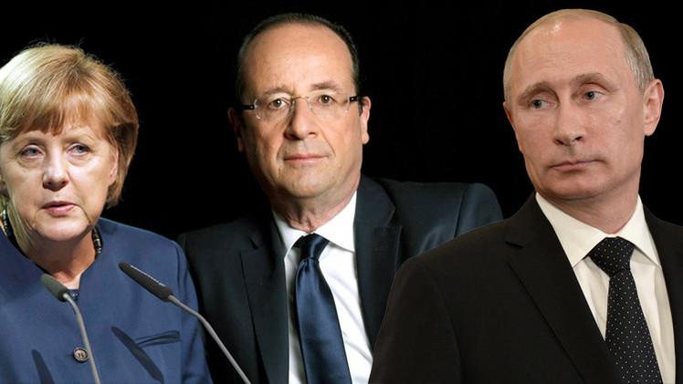 بوتين يؤكد لميركل وهولاند أهمية وقف إطلاق النار في أوكرانيا