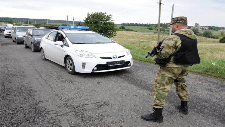 بوتين وايبوت يؤكدان ضرورة وقف النار في أوكرانيا من أجل التحقيق في تحطم الماليزية