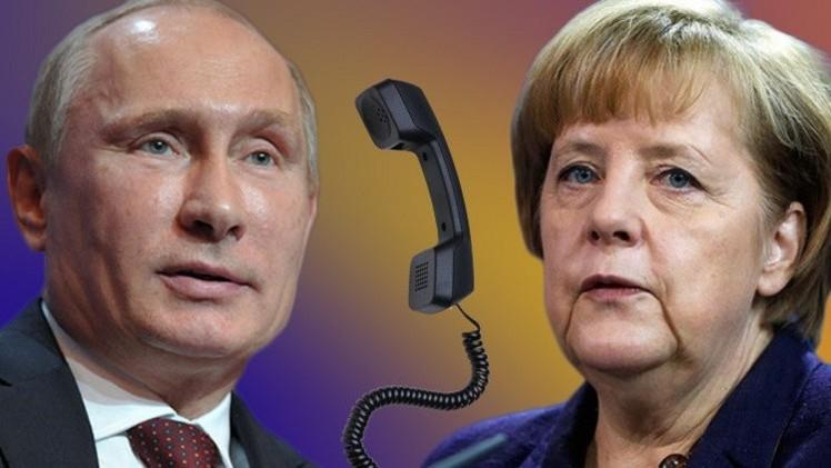 بوتين لميركل: كييف مسؤولة عما يحدث في جنوب شرق أوكرانيا
