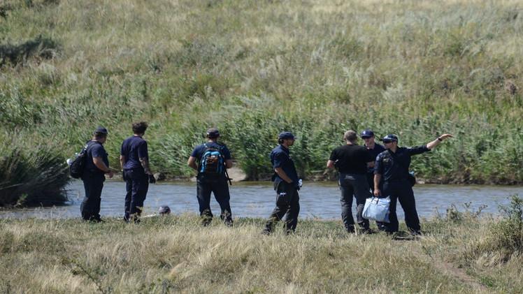 هولندا توقف عمليات البحث في موقع تحطم الماليزية بأوكرانيا