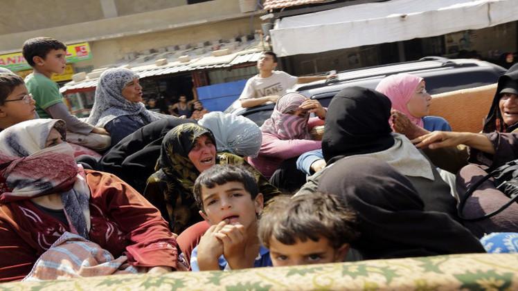 مئات اللاجئين في لبنان يعودون إلى سورية
