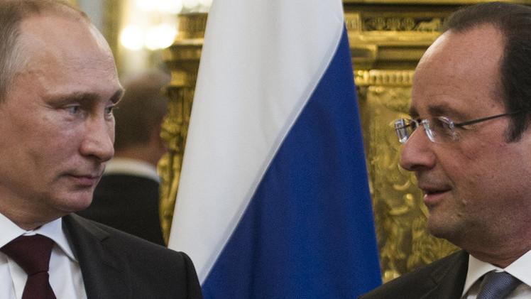 بوتين وهولاند يؤكدان على أهمية وقف القتال والتسوية السياسية في أوكرانيا