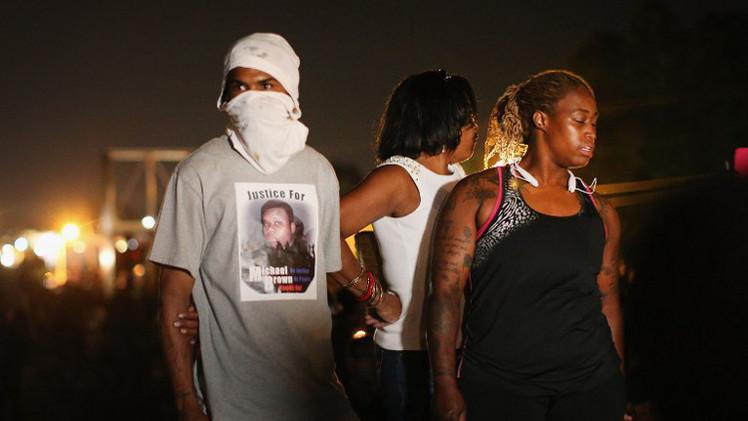 أوباما يدعو للهدوء في فيرغسن بعد احتجاجات على قتل شرطي لشاب أسود