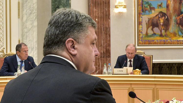 بوتين وبوروشينكو بحثا أفق العلاقات الثنائية  بعد توقيع كييف اتفاقية الشراكة الأوروبية