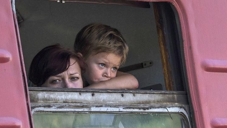 اللاجئون الأوكرانيون يطالبون رئيس بلادهم بتوفير الظروف لعودتهم