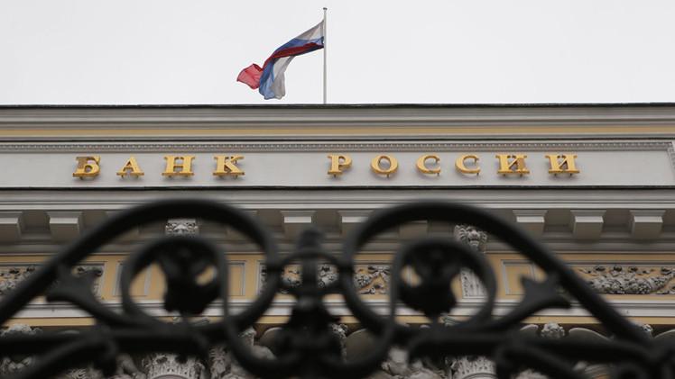 المركزي الروسي يتوقع نزوح 100 مليار دولار من روسيا في 2014