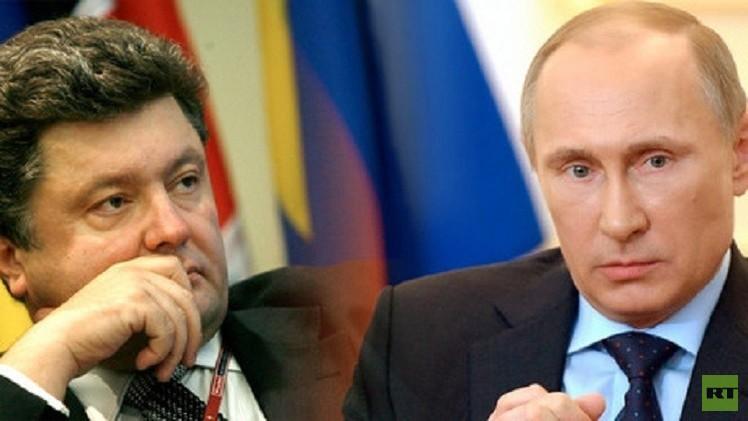 بوتين وبوروشينكو يرحبان بالتزام الأطراف المتنازعة بوقف إطلاق النار شرق أوكرانيا