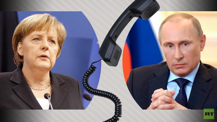 بوتين يبحث مع ميركل تنفيذ اتفاق مينسك لتسوية أزمة أوكرانيا