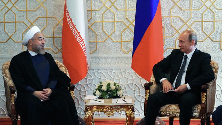 بوتين يبحث مع روحاني التعاون في مجالي الاقتصاد والطاقة