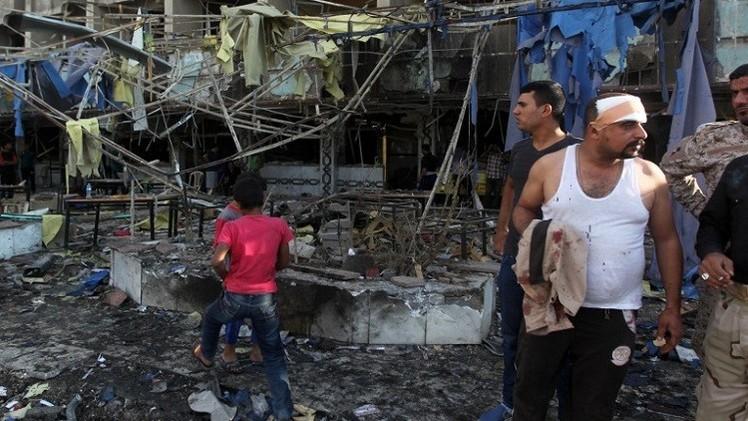 عشرات القتلى والجرحى بتفجير سيارتين مفخختين في بغداد