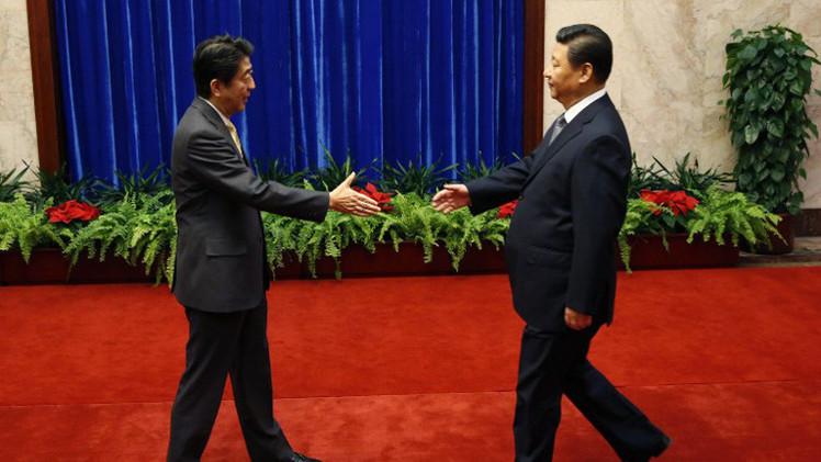 الرئيس الصيني يدعو اليابان إلى تبني سياسة عسكرية وأمنية