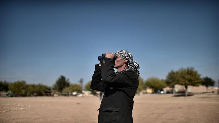 المقاتلون الأكراد يقطعون طريقا استراتيجيا لـ