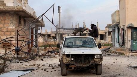 أحد عناصر الجماعات المسلحة في سوريا