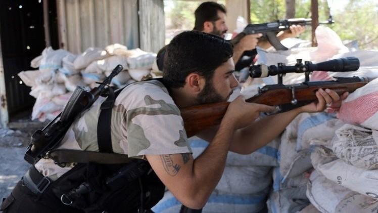 اشتباكات بين فصائل المعارضة من أجل السيطرة على حي قرب دمشق