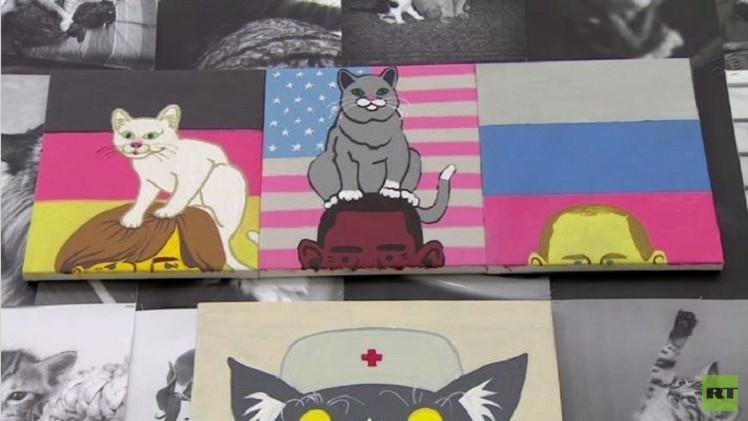 موسكو.. معرض مختص بالقطط يتخلله أوباما وميركل (فيديو)