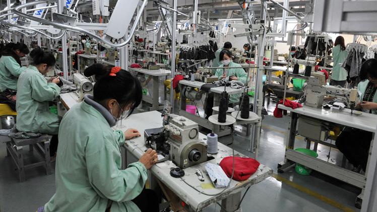 نمو الاقتصاد الصيني يتباطأ في 2014 مسجلا أضعف مستوى في 24 سنة