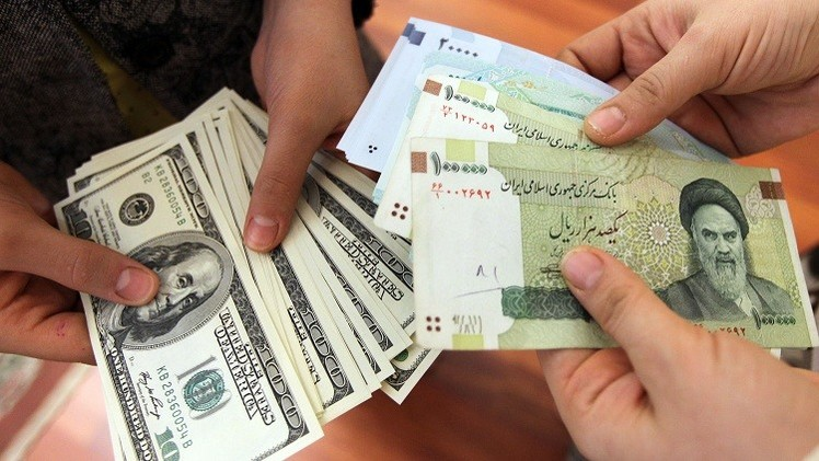 إيران توقف التعامل بالدولار الأمريكي في التبادلات التجارية