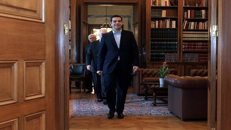 هولاند يدعو رئيس الحكومة اليونانية للتوجه إلى باريس فورا