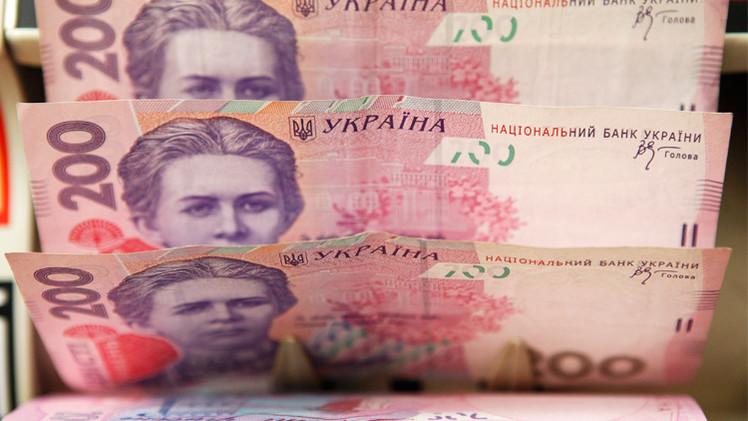 الهريفنا الأوكرانية تهوي إلى مستويات قياسية أمام الدولار
