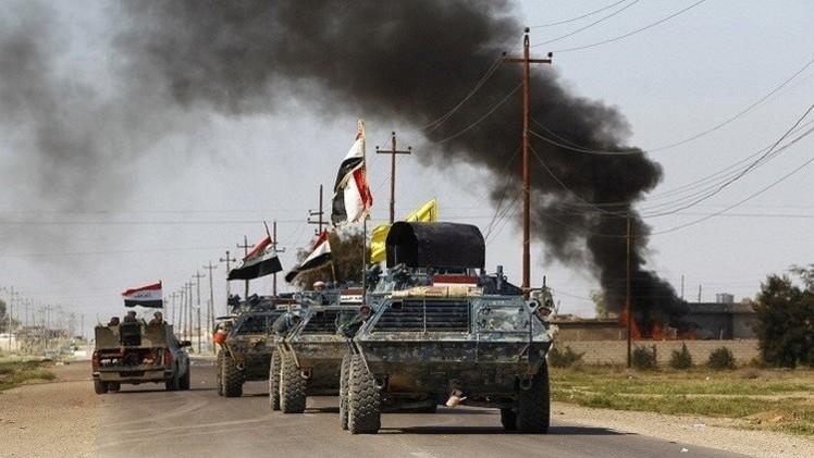 القوات العراقية تحرر مبنى قائم مقامية بيجي من قبضة