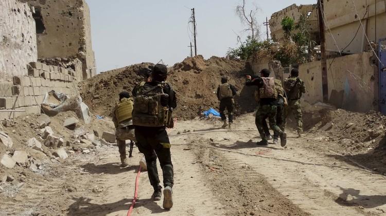 القوات العراقية تتقدم صوب الرمادي ونشر 4 آلاف متطوع لتأمين بادية النجف