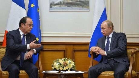 الرئيسان الروسي فلاديمير بوتين والفرنسي فرانسوا هولاند. صورة أرشيفية