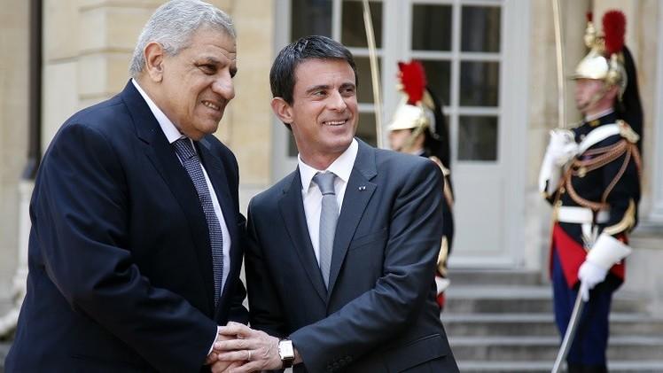 رئيس الوزراء الفرنسي مانويل فالس ورئيس الوزراء المصري إبراهيم محلب