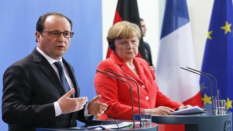 برلين وباريس تحثان اليونان على الإسراع في المباحثات مع مقرضيها