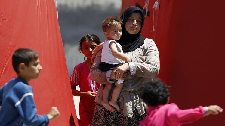 نحو 2000 لاجىء يعبرون إلى تركيا بسبب المعارك في سوريا