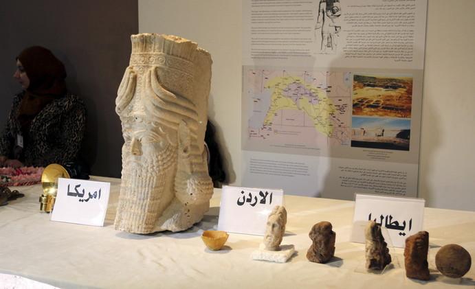 العراق يحتفل باستعادة 800 قطعة أثرية تاريخية